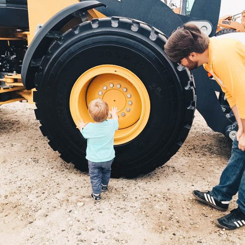 child with father at    redlands touch a truck event